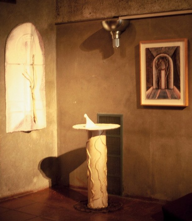 Light shining a sundial, a shield, and a monoprint