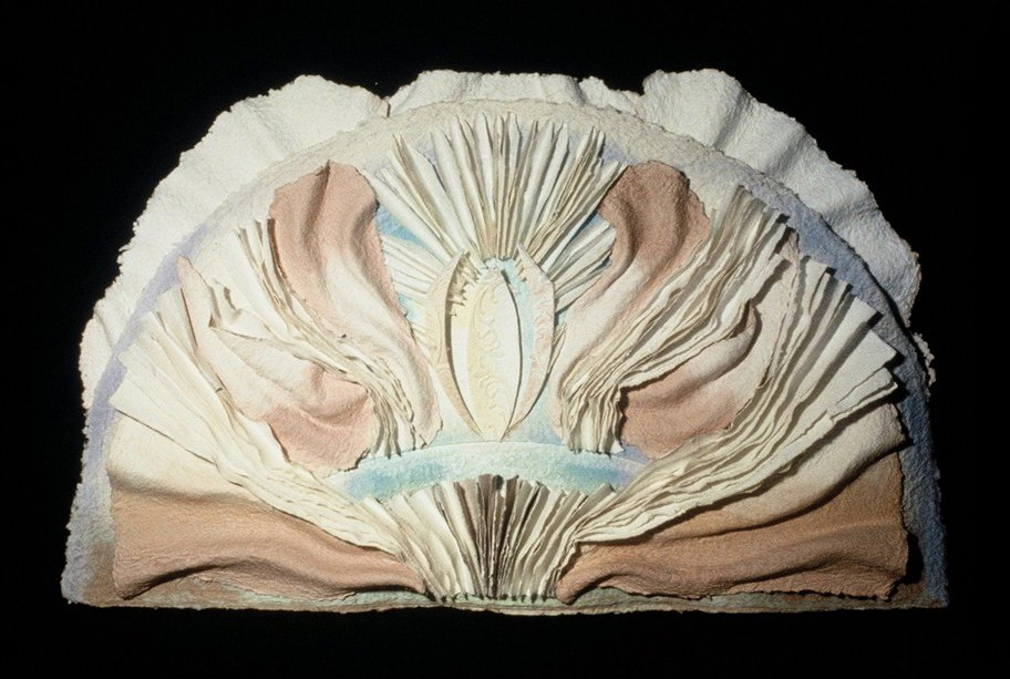 A paper sculpture that looks like a shell